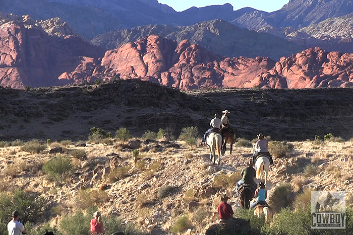 Picture of riders and the Calico Hills at sunset at Cowboy Trail Rides taken while Horseback Riding in Las Vegas